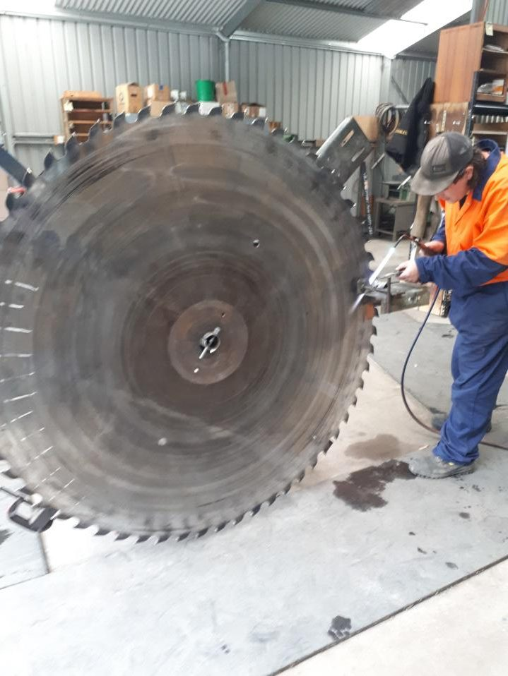 Large saw blade being sharpened and serviced by Huon Saw Service - Hobart and Southern Tasmania